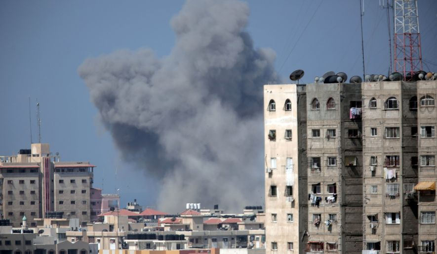 Smoke rises over Gaza City after an Israeli strike, Friday, Aug. 8, 2014, as Israel and Gaza militants resumed cross-border attacks after a three-day truce expired and Egyptian-brokered talks on a new border deal for blockaded Gaza hit a deadlock. (AP Photo/Khalil Hamra)