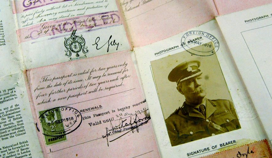 "This May 13, 2004 file photo shows Sir Arthur Conan Doyle's passport dating from World War I on display at Christie's auction house in London. The passport and some 3,000 other items were among Doyle's lost papers that were found in a London law firm's archive where they were stored and forgotten after they were taken from Doyle's writing desk in 1930, following his death. Arthur Conan Doyle met with troops in the spring of 1916 and completed his work ""A Visit To Three Fronts"" over the summer. (AP Photo/Alastair Grant, File)"