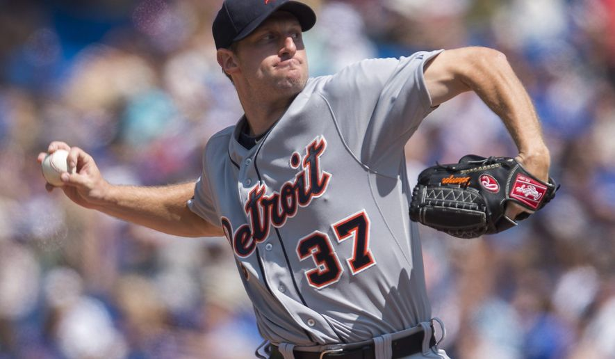 Detroit Tigers starting pitcher Max Scherzer works against the Toronto Blue Jays during the first inning of a baseball game in Toronto on Saturday, Aug. 9, 2014. (AP Photo/The Canadian Press, Darren Calabrese)