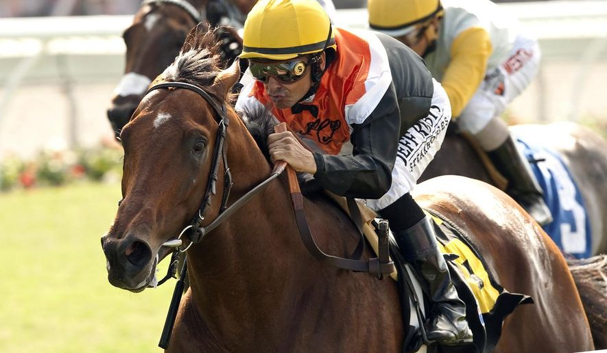 In a photo provided by Benoit Photo, Farm's Enterprising and jockey Mike Smith win the Grade III, $150,000 La Jolla Handicap horse race, Saturday, Aug. 9, 2014, at Del Mar Thoroughbred Club in Del Mar, Calif. (AP Photo/Benoit Photo)