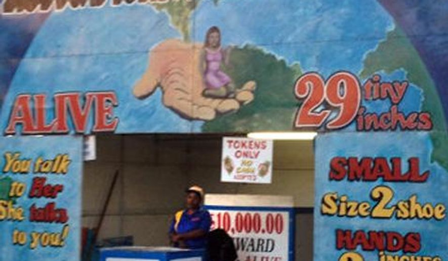 This undated photo shows the World's Smallest Woman exhibit at the Boulder County Fair in Longmont, Colo. The show featuring a 29-inch-tall woman from Haiti was closed Thursday, Aug. 7, 2014, after two parents complained, The (Longmont) Times-Call reported. (AP Photo/The Daily Times Call) NO SALES