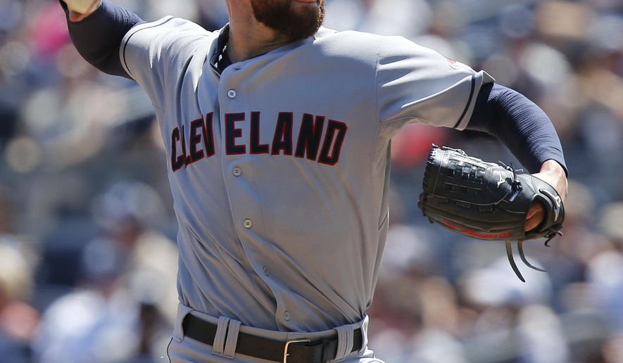 Cleveland Indians' Corey Kluber delivers a pitch during the first inning of a baseball game against the New York Yankees, Saturday, Aug. 9, 2014, in New York. (AP Photo/Jason DeCrow)