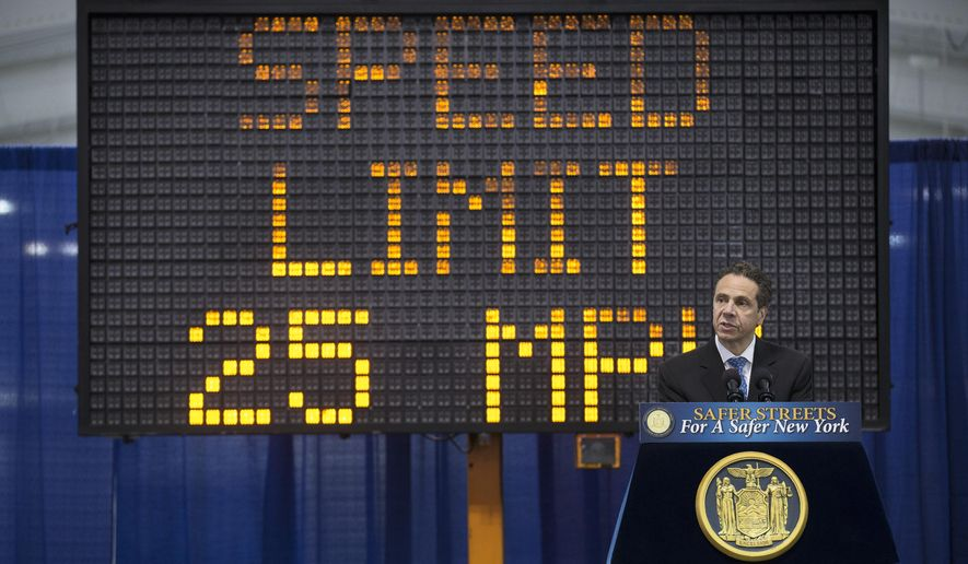 New York Gov. Andrew Cuomo speaks to the media during a news conference and bill signing that authorizes New York City to lower their speed limit, Saturday, Aug. 9, 2014, in New York. (AP Photo/John Minchillo)