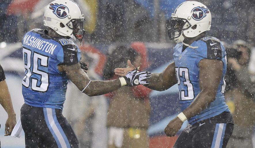 Tennessee Titans running back Shonn Greene (23) is congratulated by wide receiver Nate Washington (85) after scoring a touchdown on a 13-yard run against the Green Bay Packers in the first quarter of a preseason NFL football game Saturday, Aug. 9, 2014, in Nashville, Tenn. (AP Photo/Mark Zaleski)