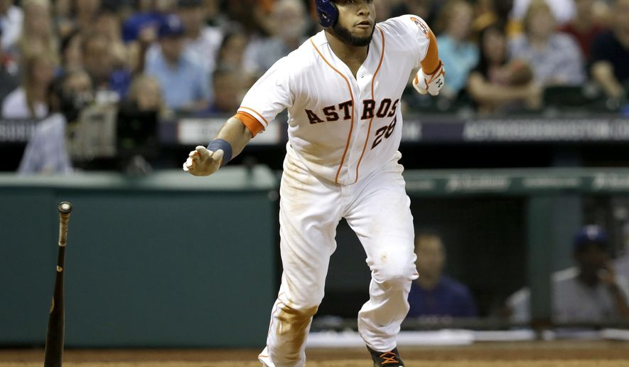 Houston Astros' Jon Singleton tosses his bat and heads up the first base line on a bases-loaded, two-run double against the Texas Rangers in the fifth inning of a baseball game Saturday, Aug. 9, 2014, in Houston. (AP Photo/Pat Sullivan)