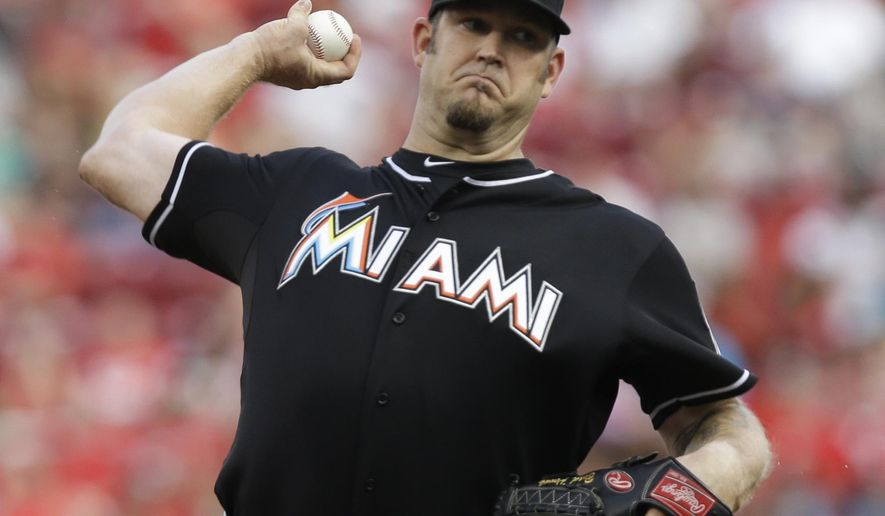 Miami Marlins starting pitcher Brad Penny throws against the Cincinnati Reds in the first inning of a baseball game, Saturday, Aug. 9, 2014, in Cincinnati. (AP Photo/Al Behrman)