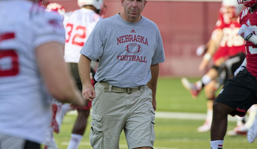 In this Aug. 4, 2014 photo, Nebraska head coach Bo Pelini watches NCAA college football practice in Lincoln, Neb. (AP Photo/The Journal-Star, Ted Kirk) LOCAL TELEVISION OUT; KOLN-TV OUT; KGIN-TV OUT; KLKN-TV OUT