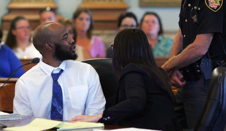 In this Thursday, Aug. 7, 2014, photo, defendant Willie Qirat turns around and verbally attacks Joseph Brandon Elliott as Elliott made his final comments during Qirat's sentencing in a Licking County court in Newark, Ohio. A jury convicted Qirat of attempted murder and other charges in the shooting of Elliott, who is now paralyzed from the chest down. (AP Photo/Newport Advocate/Michael Lehmkuhle)