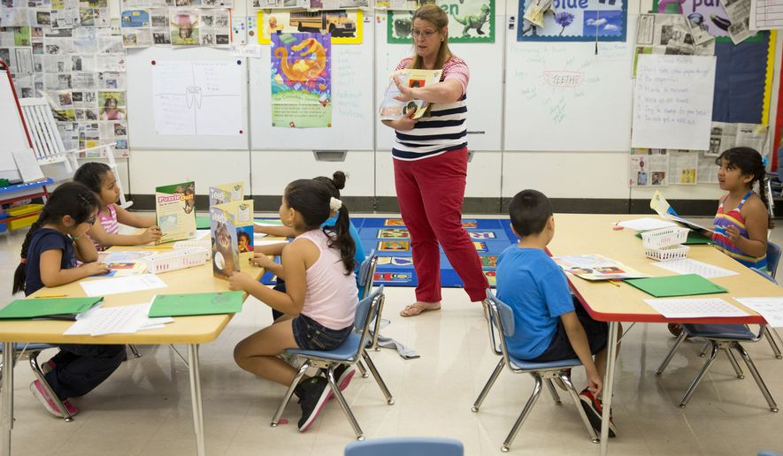 This photo taken July 21, 2014, shows teacher Jane Cornell working with young students on their storytelling skills during summer school at Mary D. Lang Kindergarten Center in Kennett Square, Pa. (AP Photo/Matt Rourke) ** FILE **