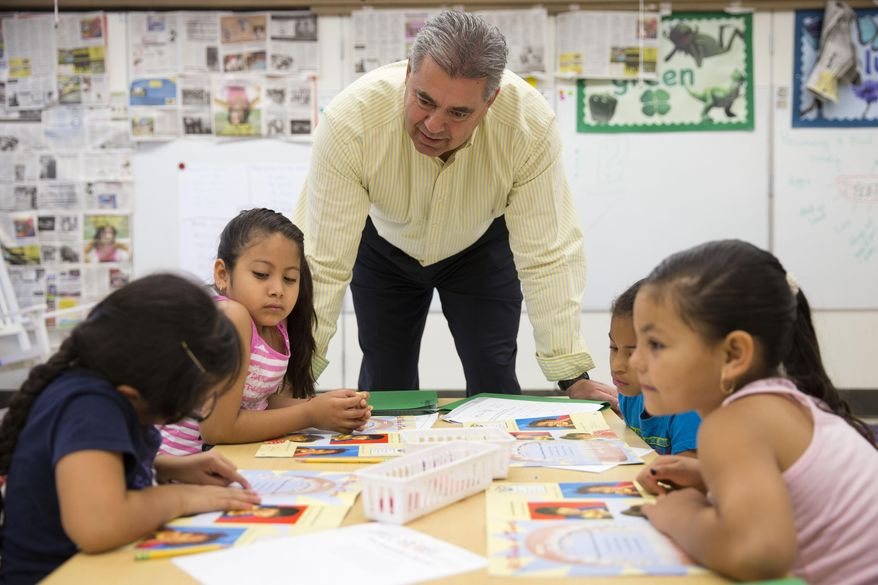 This photo taken July 21, 2014 shows Kennett Consolidated School District Superintendent Barry Tomasetti meeting with young students in teacher Jane Cornell's summer school class at Mary D. Lang Kindergarten Center in Kennett Square, Pa. For the first time ever _ U.S. public schools are projected this fall to have more minority students enrolled than white, a shift largely fueled by growth in the numbers of Hispanic children. White students are still expected to be the largest racial group in the public schools this year at 49.8 percent, but according to the National Center for Education Statistics, minority students, when added together, will now make up the majority. (AP Photo/Matt Rourke)