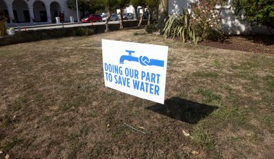 A water conservation sign is shown displayed outside of City Hall in Santa Cruz, Calif., Tuesday, July 29, 2014. (AP Photo/Bay Area News Group, Patrick Tehan) ** FILE **