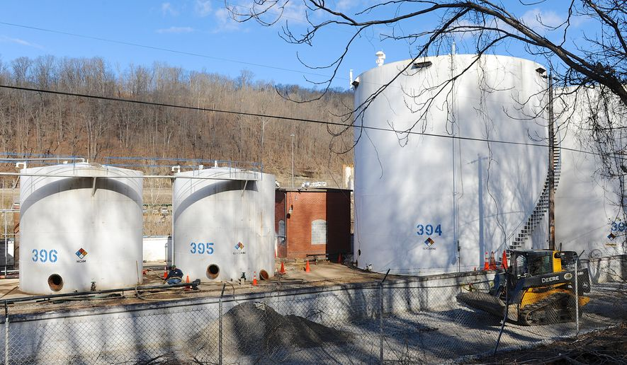 FILE - In this Mar h 15, 2014 file photo, workers at Freedom Industries prepare to dismantle chemical storage tanks in Charleston W.Va. Thousands of agencies, businesses and people are trying to squeeze millions of dollars out of the bankrupt company behind West Virginia's chemical spill in January.  Case claims agent James Lane says Freedom Industries can expect about 5,000 groups to request money in bankruptcy claims over the spill. The total sought has topped $170 million and is growing.  (AP Photo/Tyler Evert)