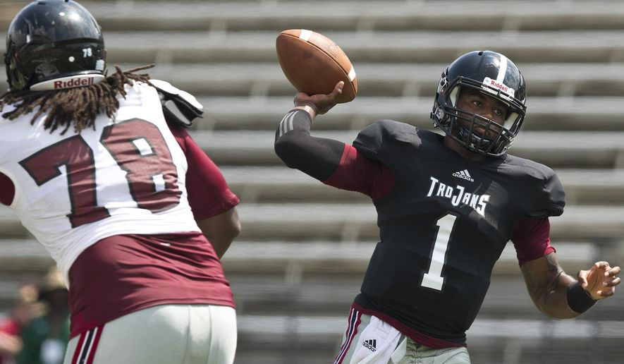 Troy's quarterback Dontreal Pruitt (1) drops back to pass the ball during an NCAA college football scrimmage on Saturday, Aug. 9, 2014, in Troy, Ala. (AP Photo/Brynn Anderson)