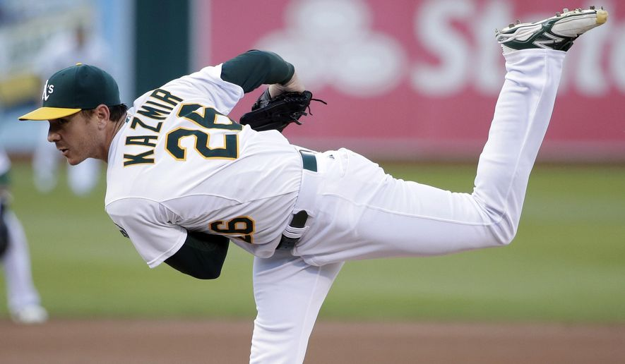 Oakland Athletics starting pitcher Scott Kazmir throws to the Minnesota Twins during the first inning of a baseball game on Friday, Aug. 8, 2014, in Oakland, Calif. (AP Photo/Marcio Jose Sanchez)