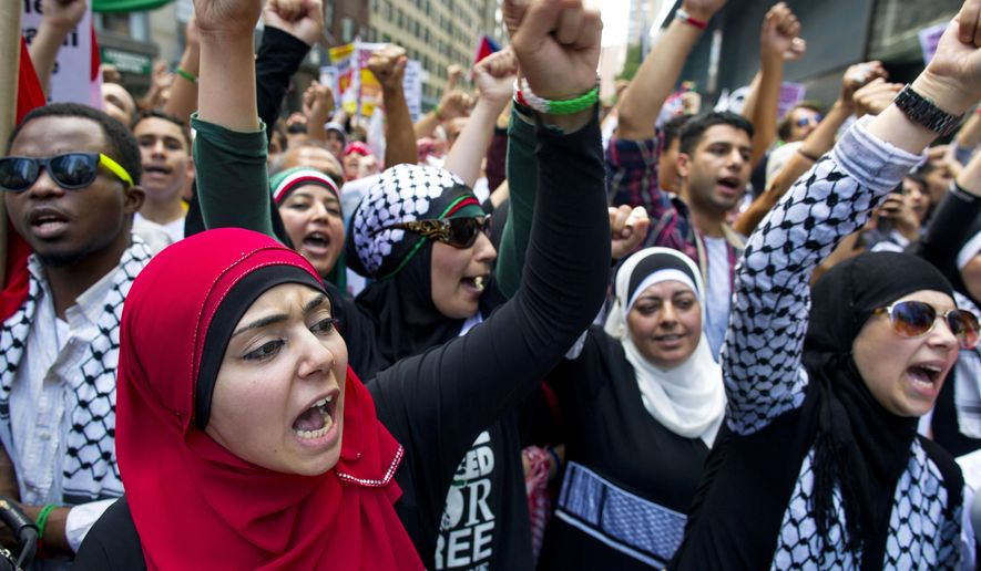 Supporters of ending the violence in Gaza yell at a rally near Columbus Circle during a protest in New York, Saturday, Aug. 9, 2014. (AP Photo/Craig Ruttle)