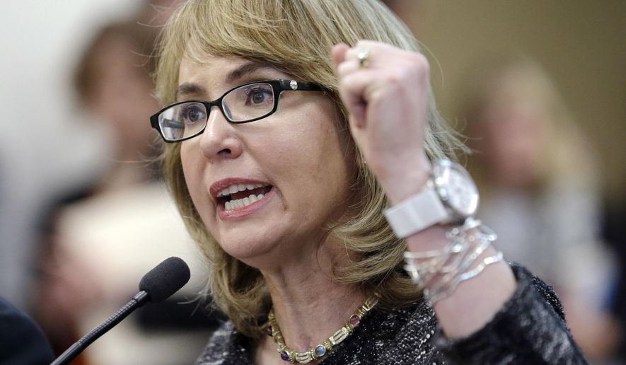 FILE - This Jan. 28, 2014 file photo shows former Arizona Congresswoman Gabrielle Giffords testifying before a Washington state House panel considering an initiative to expand firearm background checks, in Olympia, Wash. Giffords, who survived a 2011 shooting, is set to visit Maine Saturday, Aug. 9, 2014, to help raise money for Democrat gubernatorial hopeful Mike Michaud. (AP Photo/Elaine Thompson, File)