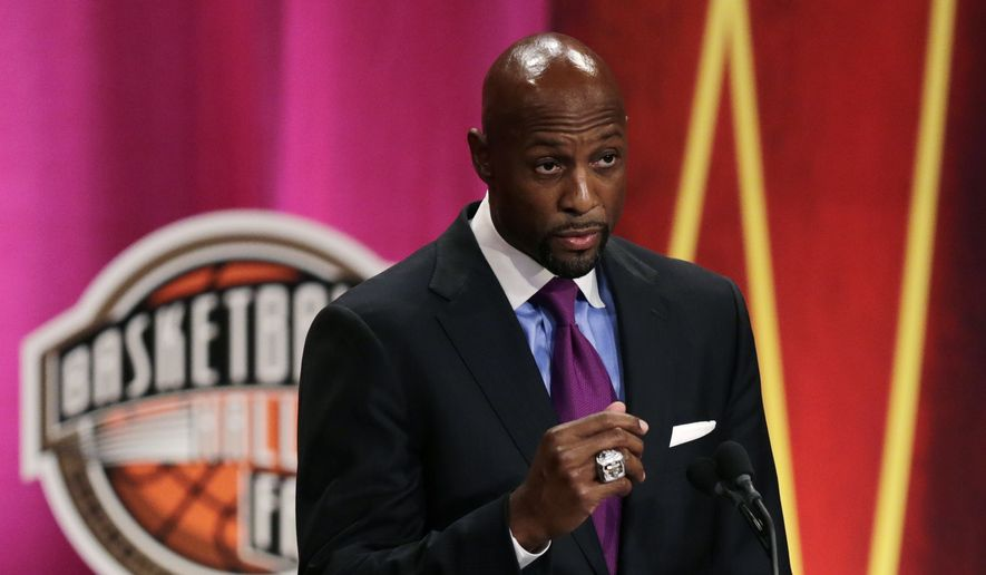 Seven-time NBA All-Star Alonzo Mourning speaks during his induction at the Basketball Hall of Fame in Springfield, Mass., Friday, Aug. 8, 2014. Mourning won an NBA championship with the Miami Heat in 2006. (AP Photo/Charles Krupa)