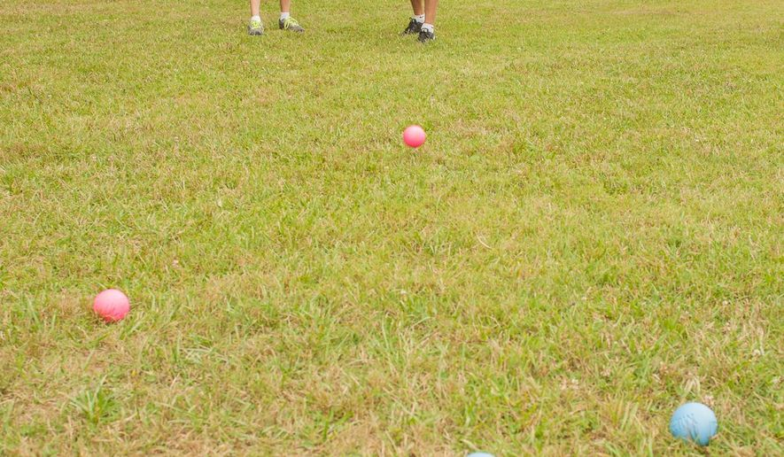 Another popular new activity at Pipestem State Park is Murbles, a game that integrates elements of marbles and bocce. The idea of the game is to toss or roll the colored balls as close to the white ball as possible. (AP Photo/The Charleston Gazette, John McCoy)