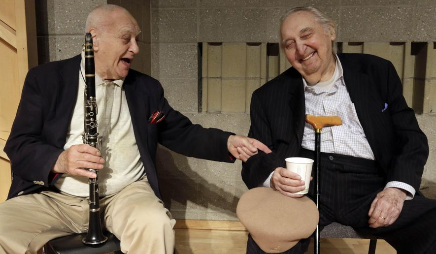 Clarinetist Sol Yaged, 91, left,  and comedian Fyvush Finkel, trade jokes during a rehearsal at the Baruch Performing Arts Center, in New York,  Friday, Aug. 8, 2014. (AP Photo/Richard Drew)