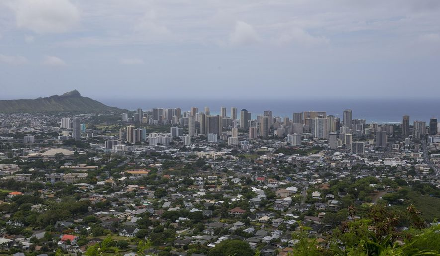 The city of Honolulu can be seen from Round Top Dr, Saturday, Aug. 9, 2014 in Honolulu.  Despite the rains and winds from Tropical Storm Iselle that pounded the state Friday, Hawaii will hold primary elections today.  (AP Photo/Marco Garcia)
