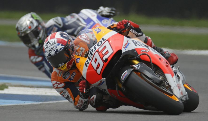 Marc Marquez, of Spain, leads Jorge Lorenzo, of Spain, on his way to winning the Indianapolis Moto GP motorcycle race at the Indianapolis Motor Speedway in Indianapolis, Sunday, Aug. 10, 2014.  (AP Photo/Michael Conroy)