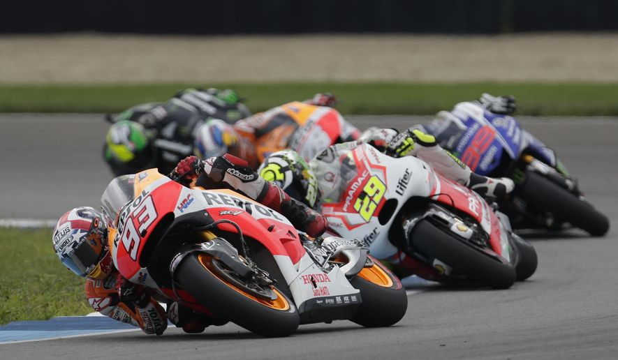 Marc Marquez (93), of Spain, leads a pack of riders around a turn during the Indianapolis Moto GP motorcycle race at the Indianapolis Motor Speedway in Indianapolis, Sunday, Aug. 10, 2014. (AP Photo/AJ Mast)
