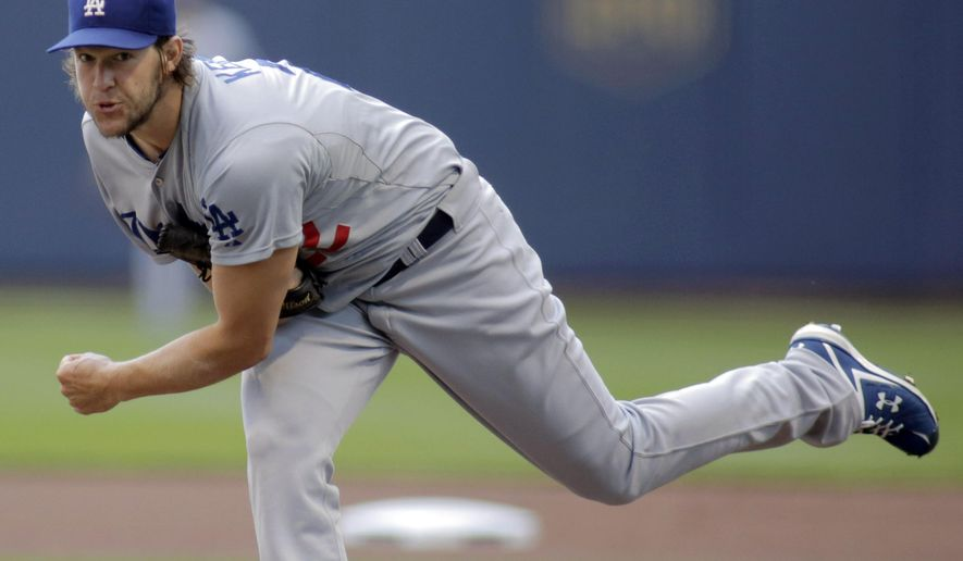 Los Angeles Dodgers pitcher Clayton Kershaw delivers to the Milwaukee Brewers during the first inning of a baseball game Sunday, Aug. 10, 2014, in Milwaukee. (AP Photo/Darren Hauck)