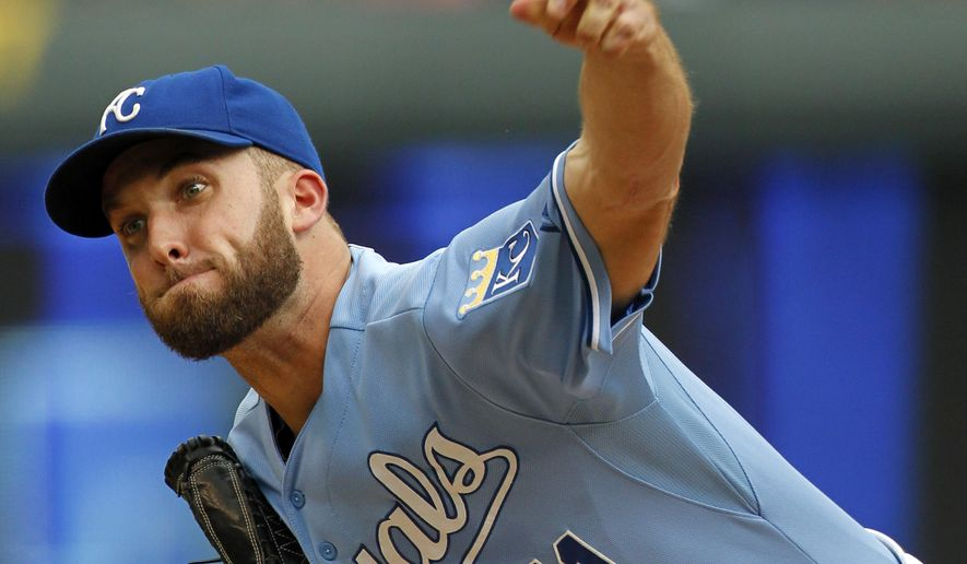 Kansas City Royals pitcher Danny Duffy throws to a batter in the first inning of a baseball game against the San Francisco Giants at Kauffman Stadium in Kansas City, Mo., Sunday, Aug. 10, 2014. (AP Photo/Colin E. Braley)
