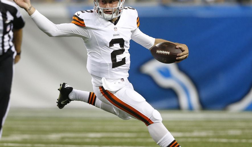 Cleveland Browns quarterback Johnny Manziel (2) scrambles against the Detroit Lions in the first half of a preseason NFL football game at Ford Field in Detroit, Saturday, Aug. 9, 2014.  (AP Photo/Rick Osentoski)