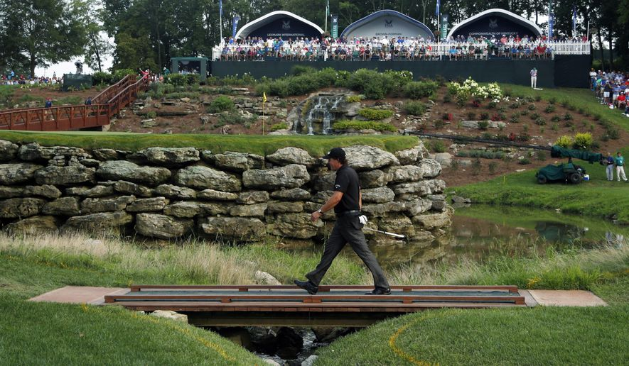 Phil Mickelson walks to 13th green during the final round of the PGA Championship golf tournament at Valhalla Golf Club on Sunday, Aug. 10, 2014, in Louisville, Ky. (AP Photo/Mike Groll)