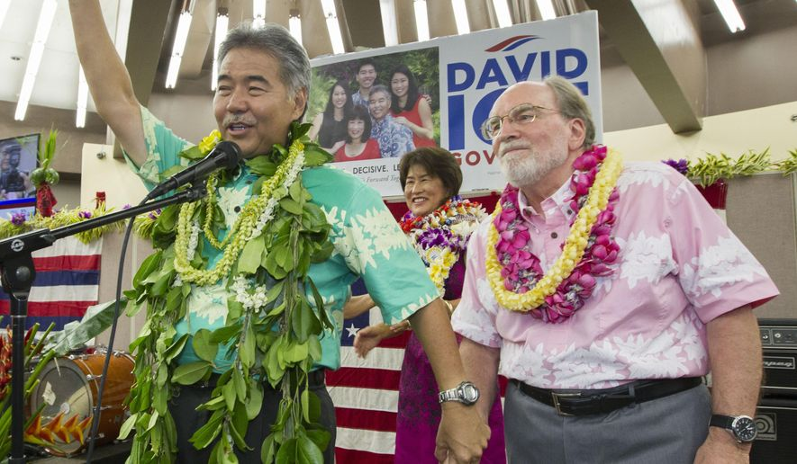 Hawaii State Sen. David Ige, right, waves to his supporters an thanks Hawaii Governor Neil Abercrombie, right, who promised his support Saturday, Aug. 9, 2014, in Honolulu. Ige defeated incumbent Hawaii Governor Neil Abercrombie in the state's primary election to win the Democratic Party's nomination. (AP Photo/Eugene Tanner)