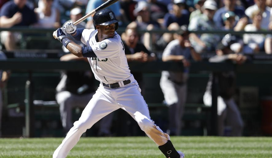 Seattle Mariners' Austin Jackson begins his swing on an RBI single in the seventh inning of a baseball game against the Chicago White Sox, Sunday, Aug. 10, 2014, in Seattle. (AP Photo/Ted S. Warren)