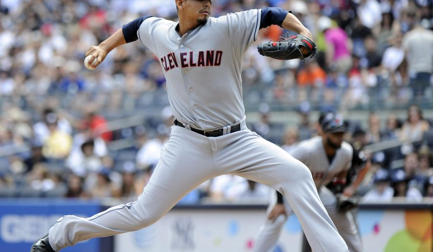 Cleveland Indians pitcher Carlos Carrasco delivers the ball to the New York Yankees during the first inning of a baseball game Sunday, Aug. 10, 2014, at Yankee Stadium in New York. (AP Photo/Bill Kostroun)
