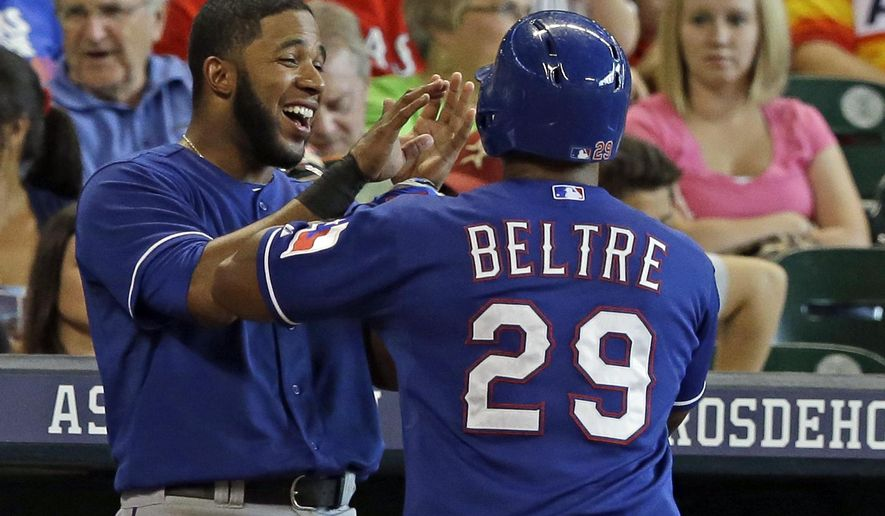 Texas Rangers' Adrian Beltre (29) is congratulated by Elvis Andrus, left, on his solo homer against the Houston Astros in the sixth inning of a baseball game Sunday, Aug. 10, 2014, in Houston. (AP Photo/Pat Sullivan)
