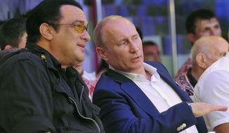 This is a Saturday, Aug. 11, 2012, file photo  Russian President Vladimir Putin, and U.S. actor Steven Seagal, left, as they watch the first Russian national championship of mixed martial arts in the Black Sea resort of Sochi, southern Russia. (AP Photo/RIA-Novosti,  Alexei Nikolsky, Presidential Press Service, File)