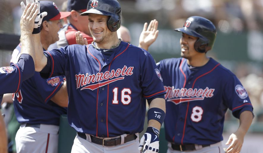 Minnesota Twins' Josh Willingham (16) is congratulated after hitting a two-run home run off Oakland Athletics' Luke Gregerson in the eighth inning of a baseball game Sunday, Aug. 10, 2014, in Oakland, Calif. (AP Photo/Ben Margot)