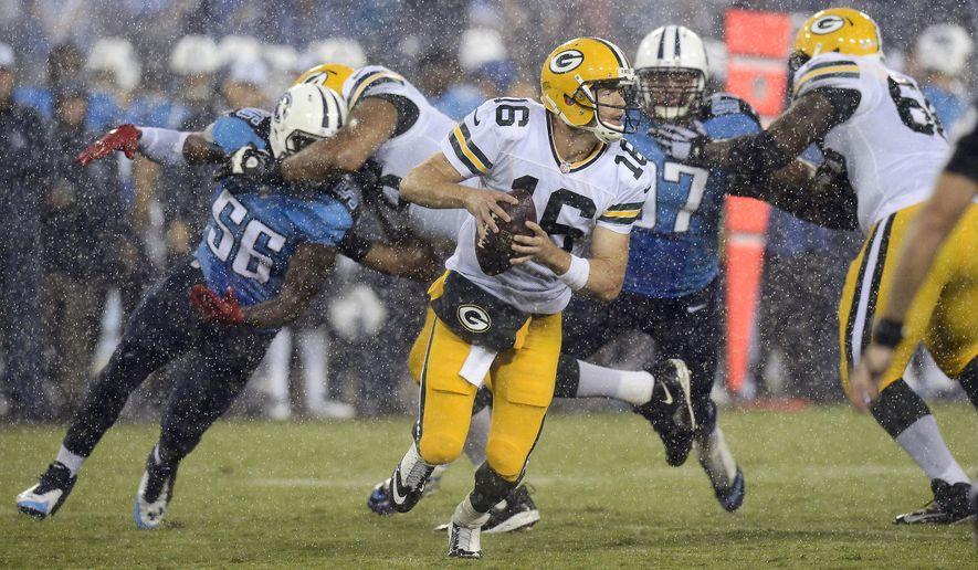 Green Bay Packers quarterback Scott Tolzien (16) scrambles away from Tennessee Titans defenders Akeem Ayers (56) and Karl Klug (97) in the third quarter of a preseason NFL football game Saturday, Aug. 9, 2014, in Nashville, Tenn. (AP Photo/Mark Zaleski)