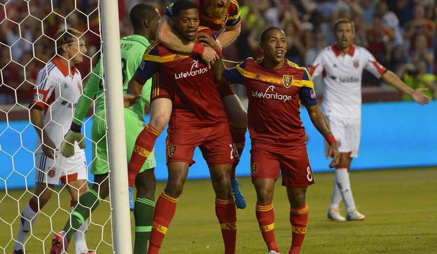 Real Salt Lake defender Chris Schuler (28) reacts to his second goal with defender Nat Borchers (6) and forward Joao Plata (8) during the first half of an MLS soccer game against DC United, Saturday, Aug. 9, 2014, in Sandy, Utah. (AP Photo/The Salt Lake Tribune, Leah Hogsten) DESERET NEWS OUT; LOCAL TELEVISION OUT; MAGAZINES OUT