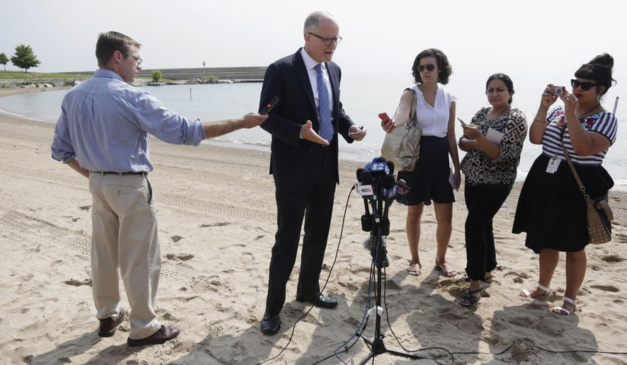 In this Aug. 4, 2014 photo, Paul Vallas, the Democratic candidate for Illinois lieutenant governor, speaks at a news conference on the shore of Lake Michigan in Chicago. The candidates for Illinois lieutenant governor don't just differ on policy issues, the Democratic former school executive and Republican councilwoman are playing starkly contrasting roles on the campaign trail. Gov. Pat Quinn's pick Vallas recently has taken to Chicago events to criticize Republican Bruce Rauner's ideas and business record. while, Rauner's running mate Evelyn Sanguinetti, tends to appear alongside the businessman, emphasizing her life story as the child of immigrants. (AP Photo/M. Spencer Green)