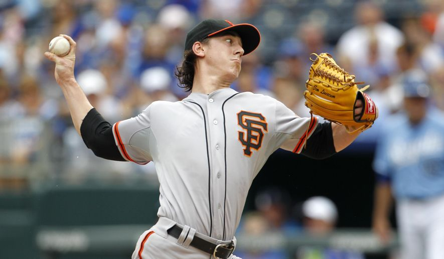 San Francisco Giants pitcher Tim Lincecum throws to a batter in the first inning of a baseball game against the Kansas City Royals at Kauffman Stadium in Kansas City, Mo., Sunday, Aug. 10, 2014. (AP Photo/Colin E. Braley)