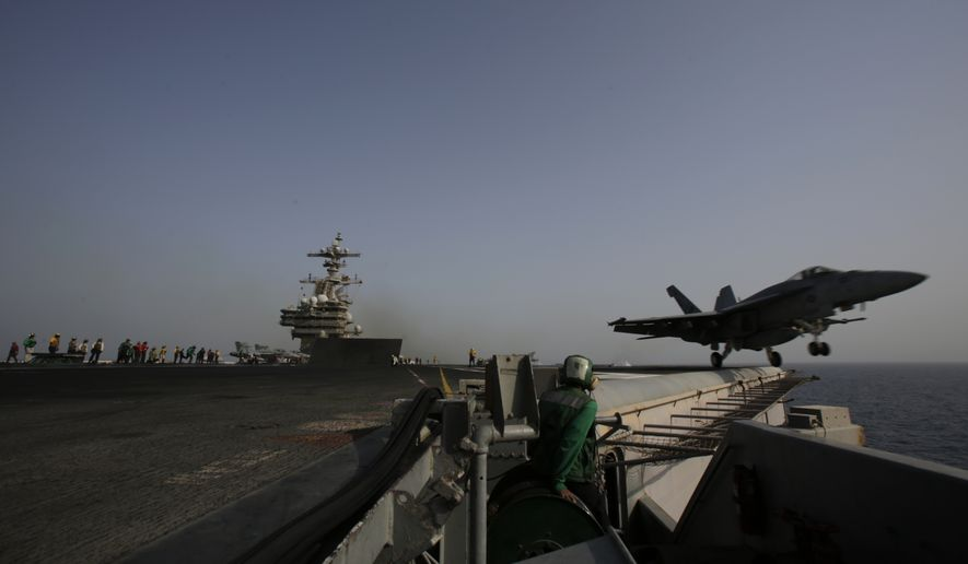 An F/A-18C Hornet takes off for Iraq from the flight deck of the U.S. Navy aircraft carrier USS George H.W. Bush on Sunday, Aug. 10, 2014 in the Persian Gulf. Aircrafts aboard the George H.W. Bush are flying missions over Iraq after U.S. President Barack Obama authorized airstrikes against Islamic militants and food drops for Iraqis trapped by the fighters. (AP Photo/Hasan Jamali)