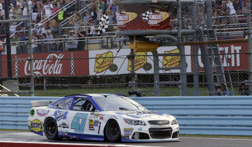 AJ Allmendinger (47) takes the checkered flag to win a NASCAR Sprint Cup Series auto race at Watkins Glen International, Sunday, Aug. 10, 2014, in Watkins Glen N.Y. (AP Photo/Derik Hamilton)