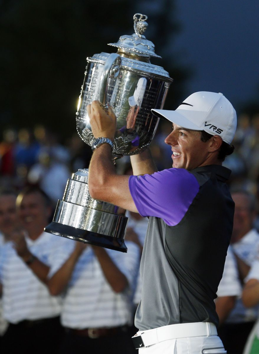 Rory McIlroy, of Northern Ireland, holds up the Wanamaker Trophy after winning the PGA Championship golf tournament at Valhalla Golf Club on Sunday, Aug. 10, 2014, in Louisville, Ky.  (AP Photo/Mike Groll)