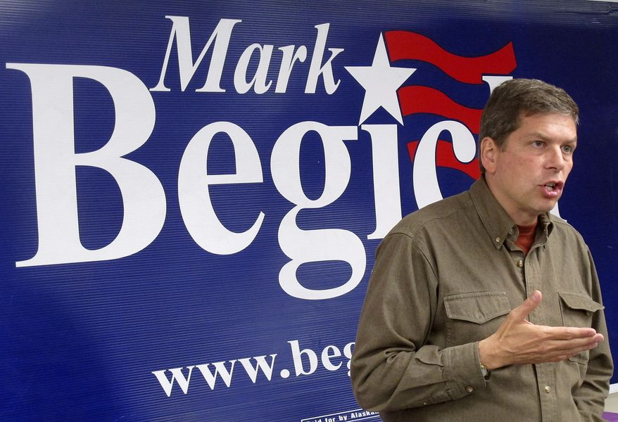 U.S. Sen. Mark Begich, D-Alaska, speaks at an event at his campaign headquarters on Wednesday, Aug. 6, 2014, in Anchorage, Alaska. A rift developed Thursday, Aug. 7, 2014, between Alaska's two U.S. senators when lawyers for Republican Lisa Murkowski demanded the campaign for Begich, her Democratic counterpart, pull ads that touts their cooperation in Washington for the benefit of Alaskans. (AP Photo/Becky Bohrer)