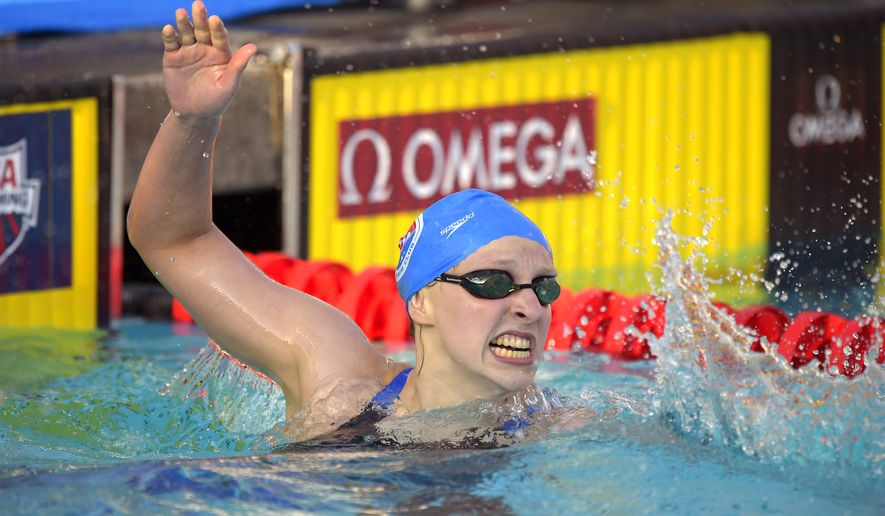 Katie Ledecky celebrates after winning the women's 400-meter freestyle final and setting a world record at the U.S. nationals of swimming, Saturday, Aug. 9, 2014, in Irvine, Calif. (AP Photo/Mark J. Terrill)