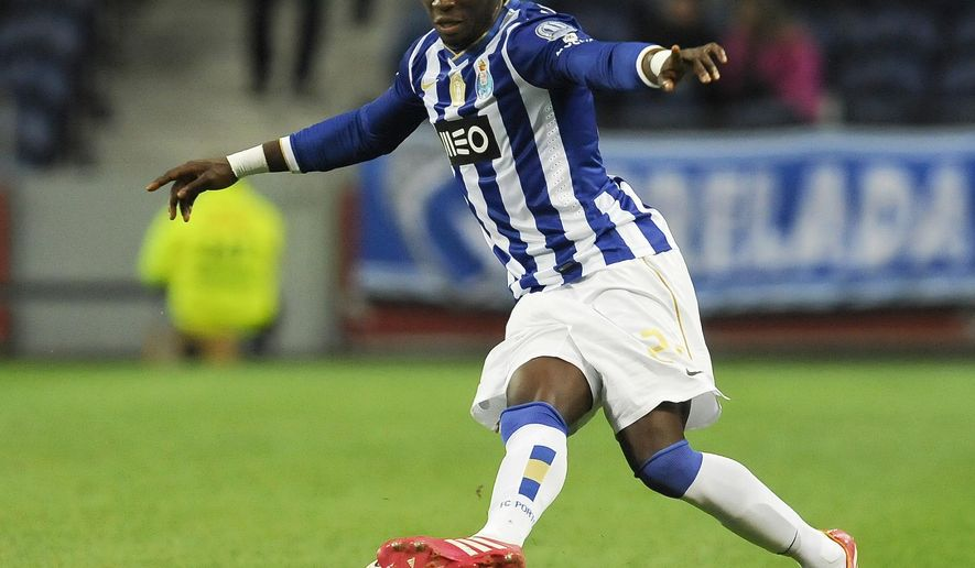 FILE - This is a Sunday, Feb. 23, 2014 file photo of FC Porto's defender Eliaquim Mangala, from France, as he controls the ball against Estoril in a Portuguese League soccer match at the Dragao stadium, in Porto, Portugal.  Manchester City on Monday Aug. 11, 2014 completed the signing of France defender Eliaquim Mangala from FC Porto for a fee reported to be about 32 million pounds ($54 million).  (AP Photo/Paulo Duarte/File)
