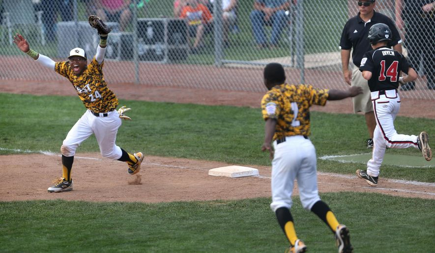 Jackie Robinson West Little League first baseman Trey Hondras, left, and winning pitcher Marquis Jackson start the celebration after the final out of the Chicago team's 12-7 win over New Albany, Ind., in the Little League Central Regional championship baseball game in Lawrence, Ind., on Saturday, Aug. 9, 2014. New Albany's Cooper Biven, right, who was the starting pitcher, runs toward first after grounding out. (AP Photo/The Indianapolis Star, Charlie Nye)