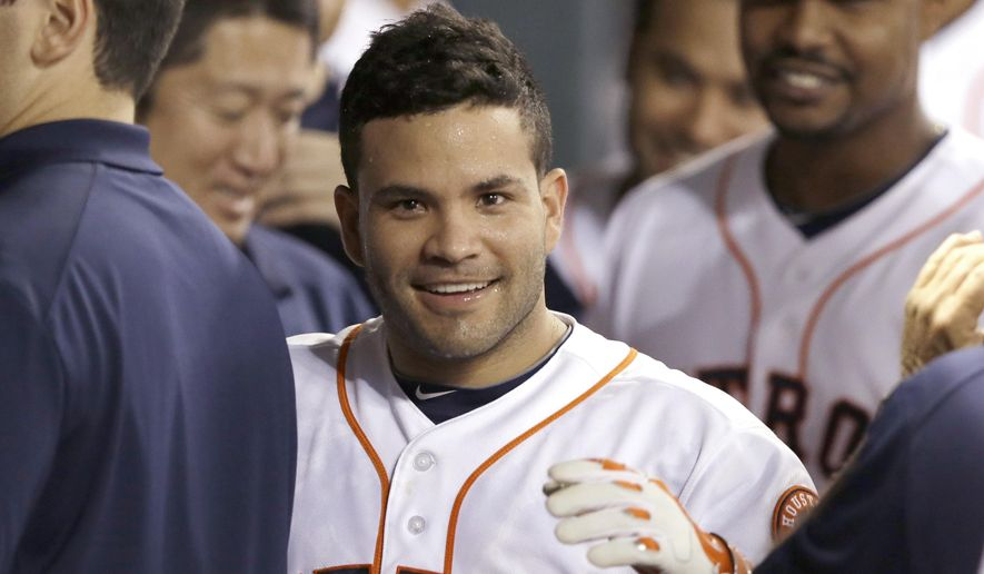 Houston Astros' Jose Altuve makes his way through the dugout after hitting a solo home run against the Minnesota Twins in the first inning of a baseball game Monday, Aug. 11, 2014, in Houston. (AP Photo/Pat Sullivan)