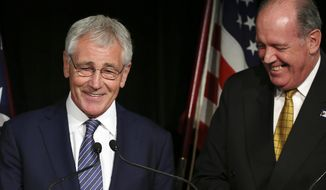 U.S. Secretary of Defense Chuck Hagel, left, and Australia's Defense Minister David Johnston enjoy a laugh when a journalist addresses Hagel as U.S. Secretary of State John Kerry during a press conference in Sydney, Australia, Monday, Aug. 11, 2014. Hagel is in Australia along with U.S. Secretary of State Kerry for talks with government officials as part of the annual Australia-United States Ministerial (AUSMIN) talks.(AP Photo/Rob Griffith, Pool)