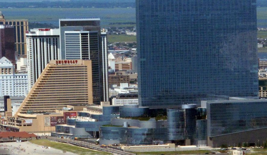This July 11, 2014 photo shows the Showboat Casino Hotel, left, and revel Casino Hotel, right, in Atlantic City N.J. On Monday Aug. 11, 2014, the New Jersey Casino Control Commission said it lacks the power to force the Showboat's owners to keep it open for four additional months past its Aug. 31 shutdown date while a buyer is sought. Meanwhile, Revel was weighing bids in advance of a bankruptcy auction, and has warned it too may shut down if a buyer can't be found.(AP Photo/Wayne Parry)